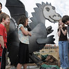 Artist Chapin Diamond, left, with Emerald Elementary School students Nathan Cote, Maya Mowery-Evans, Toree Seratt and Garrett Garnhart after uncovering the steel sculpture of the school's mascot, Snortner, during the dedication ceremony on Thursday. <br /> <br /> March 31, 2011<br /> staff photo/David R. Jennings
