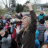 Sheri Smith keeps the attemtion of classes being photographed by Jenny Weich with the sculpture of Emerald Elementary School's mascot, Snortner,  after the dedication ceremony on Thursday.  <br /> <br /> March 31, 2011<br /> staff photo/David R. Jennings