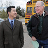 Three former and present Emerald Elementary principals John Ortner, left, David Tanaka and  Larry Leatherman wiat for the steel sculpture of the school's mascot,Snortner, to be unveiled on Thursday. <br /> March 31, 2011<br /> staff photo/David R. Jennings