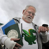 Former Emerald Elementary principal John Ortner looks at his hand made sweater with Snortner, the school's mascot, during the dedication of the steel sculpture of Snortner at the school on Thursday. Snortner is named after John Ortner. <br /> <br /> March 31, 2011<br /> staff photo/David R. Jennings