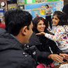 Kindergartner Riya Pathak, 5, right, hugs her mother Prih, center, while playing a math game with her father Kuntal, left, during Emerald Elementary School's Family Math Night Tuesday. 195 parents and students showed for the event an increase from a mere 8 about three years ago.<br /> <br /> November 17, 2009<br /> Staff photo/David R. Jennings