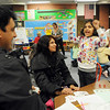 Kindergartner Riya Pathak, 5, right, cheers while playing a math game with her parents Kuntal, left, and Prih during Emerald Elementary School's Family Math Night Tuesday. 195 parents and students showed for the event an increase from a mere 8 about three years ago.<br /> <br /> November 17, 2009<br /> Staff photo/David R. Jennings