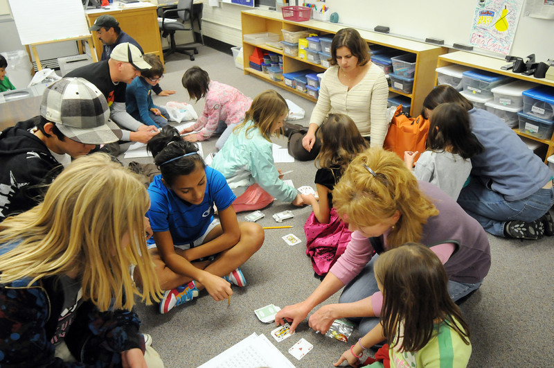 Parents and students play math games in the second grade room during Emerald Elementary School's Family Math Night Tuesday. 195 parents and students showed for the event.<br /> <br /> November 17, 2009<br /> Staff photo/David R. Jennings