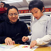 Concepcion Cortez, left, plays a math game with her son Adrian Cordova, 7, in the second grade classrom during Emerald Elementary School's Family Math Night Tuesday. 195 parents and students showed for the event.<br /> <br /> November 17, 2009<br /> Staff photo/David R. Jennings