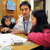 Angie Pan, 8, right, plays a math game with her father Alex and her sister Olivia, 2, in a second grade classroom during Emerald Elementary School's Family Math Night Tuesday. 195 parents and students showed for the event an increase from a mere 8 about three years ago.<br /> <br /> November 17, 2009<br /> Staff photo/David R. Jennings