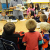 Artist Casey Horn shows a ceramic cast  while explaining to students and parents the lost wax process during Emerald Elementary School's Family Math Night Tuesday. 195 parents and students showed for the event an increase from a mere 8 about three years ago.<br /> <br /> November 17, 2009<br /> Staff photo/David R. Jennings