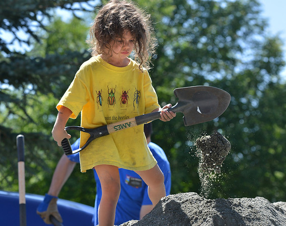 Vivenne Crutcher, 4, shovels gravel while helping load wheelbarrows lfor the new garden at Emerald Elementary School on Saturday.<br /> <br /> July 21, 2012<br /> staff photo/ David R. Jennings