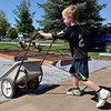 Keenan Lenihan, 6, pushes  a cart full of gravel for the new garden at Emerald Elementary School on Saturday.<br /> <br /> July 21, 2012<br /> staff photo/ David R. Jennings