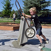 Keenan Lenihan, 6, unloads a cart full of gravel for the new garden at Emerald Elementary School on Saturday.<br /> <br /> July 21, 2012<br /> staff photo/ David R. Jennings