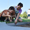 SWante Crutcher, 8, hammers a spike to hold the edging with his father Josh while they help work on the new garden at Emerald Elementary School on Saturday.<br /> <br /> July 21, 2012<br /> staff photo/ David R. Jennings