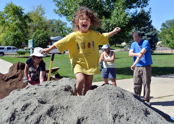 Vivenne Crutcher, 4, stands on top of a mound of gravel for the new garden at Emerald Elementary School on Saturday.<br /> <br /> July 21, 2012<br /> staff photo/ David R. Jennings