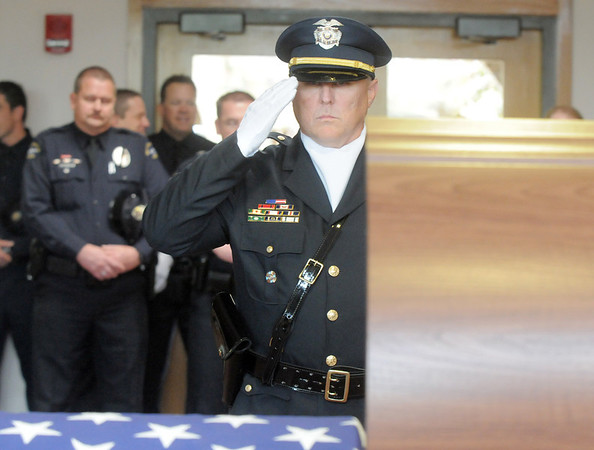 Sergeant Ron Sigman salutes at the casket of Broomfield Police detective Bruce Fitzgerald during the funeral at Spirit of Christ Church in Arvada on Thursday.<br /> May 12, 2011<br /> staff photo/David R. Jennings