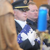 Honor Guard officer Todd Dahlbach holds the flag for Broomfield Police detective Bruce Fitzgerald during the funeral at Spirit of Christ Church in Arvada on Thursday.<br /> May 12, 2011<br /> staff photo/David R. Jennings