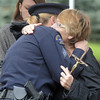 Jane Fitzgerald is hugged by Sergeant Heidi Walts at the funeral for Broomfield Police detective Bruce Fitzgerald at Spirit of Christ Church in Arvada on Thursday.<br /> May 12, 2011<br /> staff photo/David R. Jennings