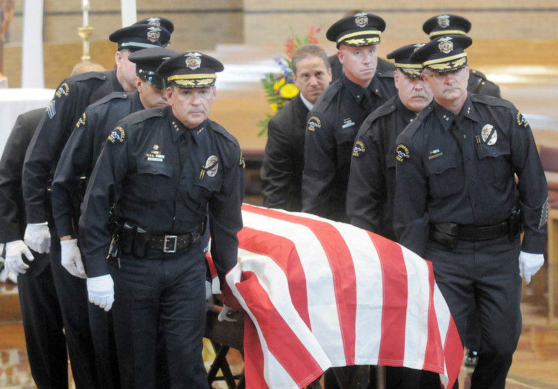 Pallbears  lead by Chief Tom Deland, left, and Deputy Chief Jim Pfankuch carry the casket of Broomfield Police detective Bruce Fitzgerald during his funeral at Spirit of Christ Church in Arvada on Thursday.<br /> May 12, 2011<br /> staff photo/David R. Jennings