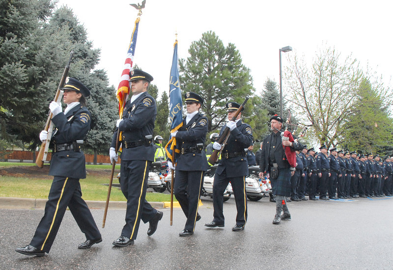 The Broomfeild Police Honor Guard marches away after the funeral for Broomfield Police detective Bruce Fitzgerald at Spirit of Christ Church in Arvada on Thursday.<br /> May 12, 2011<br /> staff photo/David R. Jennings