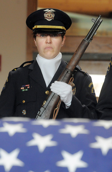Honor guard member Officer Carol Lucero stands guard at the casket  of  detective Bruce Fitzgerald during his funeral at Spirit of Christ Church in Arvada on Thursday.<br /> May 12, 2011<br /> staff photo/David R. Jennings