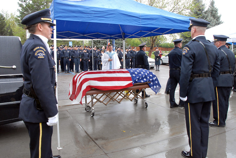 The Broomfield Police Honor Guard stands guard over the casket of Broomfield Police detective Bruce Fitzgerald during the funeral at Spirit of Christ Church in Arvada on Thursday.<br /> May 12, 2011<br /> staff photo/David R. Jennings
