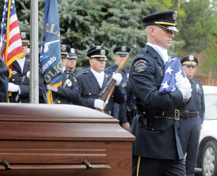 Honor Guard officer Todd Dahlbach carries the flag for Broomfield Police detective Bruce Fitzgerald to be given to Fitzgerald's family during the funeral at Spirit of Christ Church in Arvada on Thursday.<br /> May 12, 2011<br /> staff photo/David R. Jennings