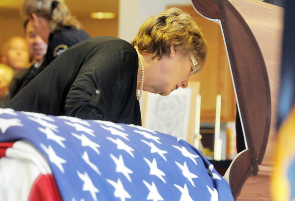 Jane Fitzgerald says a final goodbye to her husband Broomfield Police detective Bruce Fitzgerald during the funeral at Spirit of Christ Church in Arvada on Thursday.<br /> May 12, 2011<br /> staff photo/David R. Jennings