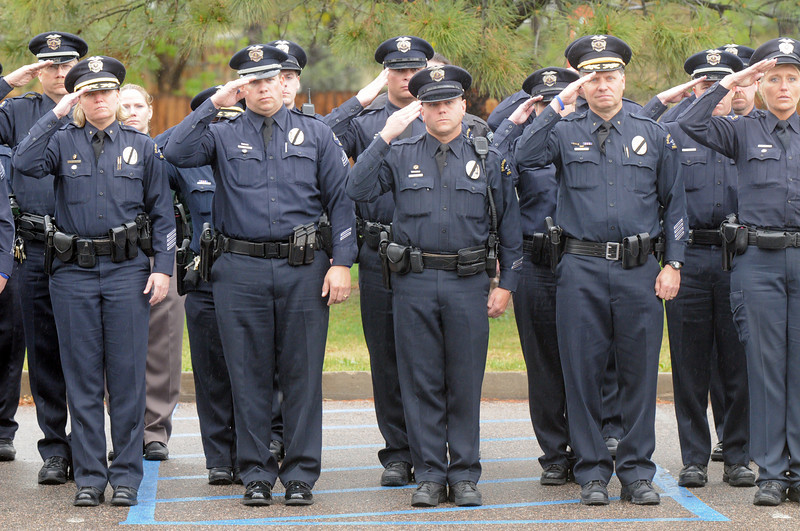 Broomfield Police officers salute as the casket of detective Bruce Fitzgerald is carried out of Spirit of Christ Church in Arvada during the funeral on Thursday.<br /> May 12, 2011<br /> staff photo/David R. Jennings