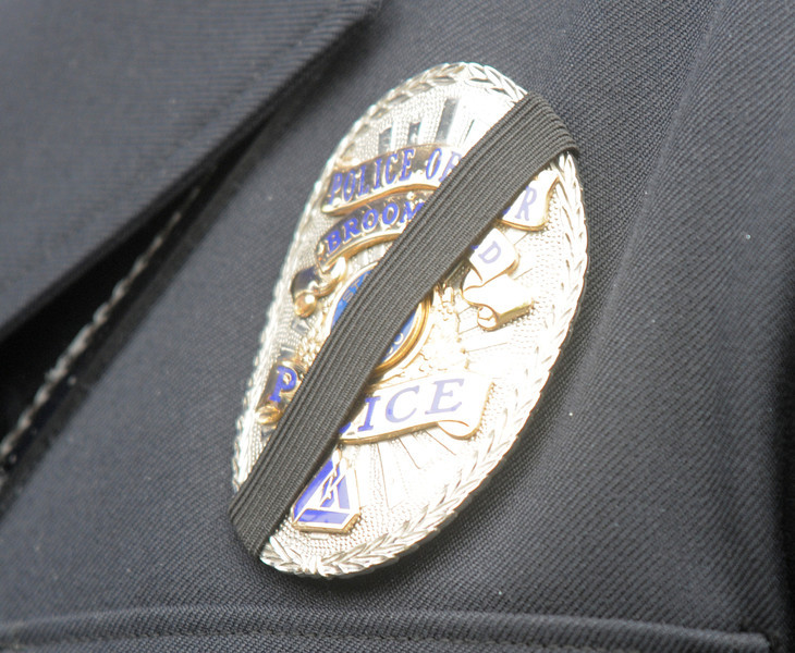 Broomfield Police officer's badge with a black ribbon in memory of detective Bruce Fitzgerald during his funeral at Spirit of Christ Church in Arvada on Thursday.<br /> May 12, 2011<br /> staff photo/David R. Jennings