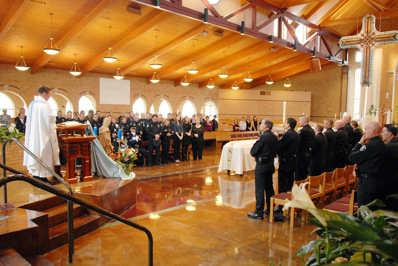 Father Matthew Book speaks during the funeral for Broomfield Police Ddetective Bruce Fitzgerald at Spirit of Christ Church in Arvada on Thursday.<br /> May 12, 2011<br /> staff photo/David R. Jennings