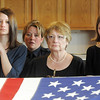The family of Broomfield Police detective Bruce Fitzgerald, his daughter, Meghan Fitzgerald-Brown, left, wife, Jane Fitzgerald and daughter Erin Fitzgerald watch the flag being folded during the funeral at Spirit of Christ Church in Arvada on Thursday.<br /> May 12, 2011<br /> staff photo/David R. Jennings