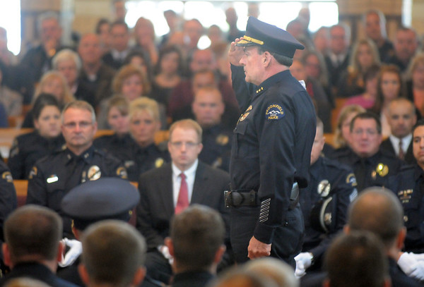 Broomfield Police Chief Tom Deland gives a final salute to detective Bruce Fitzgerald during the funeral at Spirit of Christ Church in Arvada on Thursday.<br /> May 12, 2011<br /> staff photo/David R. Jennings