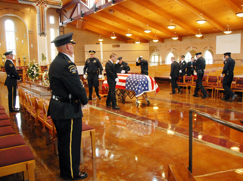 The pallbearers prepare to carry the casket of Broomfield Police detective Bruce Fitzgerald out of the Spirit of Christ Church in Arvada on Thursday.<br /> May 12, 2011<br /> staff photo/David R. Jennings