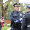Broomfield Police Chief Tom Deland receives the flag from honor guard member Sgt. Ron Sigman during the funeral for Broomfield Police detective Bruce Fitzgerald at Spirit of Christ Church in Arvada on Thursday.<br /> May 12, 2011<br /> staff photo/David R. Jennings