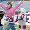 Michelle Lucero, a breast cancer patient, runs through the Buckeye banner with her son Ryan to start the game dedicated to her by the Buckeyes a Broomfield Youth Football team playoff game at Elizabeth Kennedy Stadium. The team wore pink items to help raise awareness to fight breast cancer.<br /> October 9, 2010<br /> staff photo/David R. Jennings