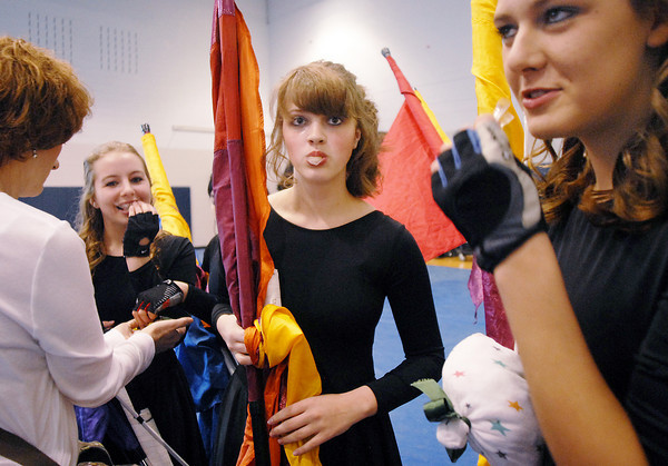 Broomfield High's Color Guard eat mints for good luck before their performance at the Rocky Mountain Color Guard Assoc. State competition at Legacy High School.<br /> <br /> March 27, 2010<br /> Staff photo/David R. Jennings