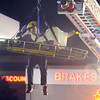 North Metro Fire Rescue paramedic Matt Gintzler rides with an injured worker for a technical rescue off of the roof of the Diamond Shamrock Station at 10th and US 287 on Wednsday evening. The worker suffered a dislocated knee while working on the roof of the building.<br /> December 23, 2010<br /> staff photo/David R. Jennings