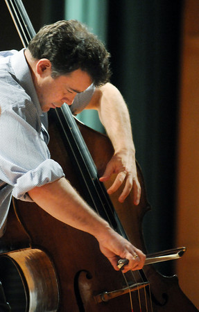 Edgar Meyer plays his bass during the lecture-demonstration master class with Mike Marshall before the benefit concert for the Broomfield High School orchestra.<br /> <br /> April 17, 2010<br /> Staff photo/David R. Jennings