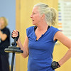 Katherine Crosby holds a weight bar before exercising during the Body Pump class at the Paul Derda Recreation Center on Thursday.<br /> January 3, 2013<br /> staff photo/ David R. Jennings