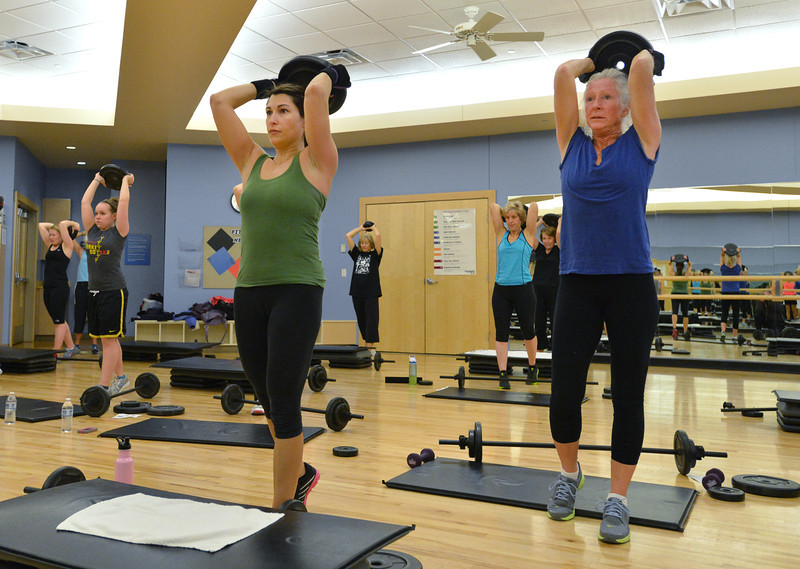 Mel Gore, left, and Katherine Crosby lift free weights during the Body Pump class at the Paul Derda Recreation Center on Thursday.<br /> January 3, 2013<br /> staff photo/ David R. Jennings