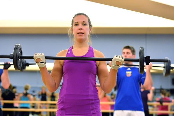 Morgan Ernzen lifts free weights during the Bodu Pump class at the Paul Derda Recreation Center on Thursday.<br /> January 3, 2013<br /> staff photo/ David R. Jennings