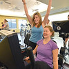 Julie Soltis, left, gives a cheer after figuring out how to start an exercise machine for Stacy Dukes, right, at the Paul Derda Recreation Center on Thursday.<br /> January 3, 2013<br /> staff photo/ David R. Jennings