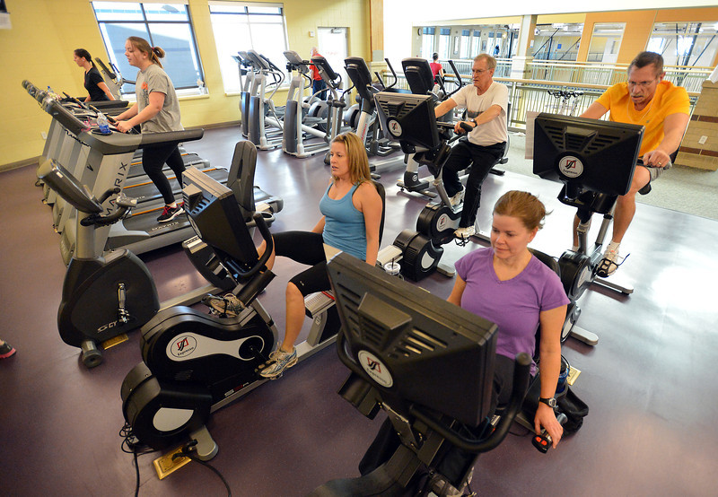 Julie Soltis, left, and Stacy Dukes use exercise machines at the Paul Derda Recreation Center on Thursday.<br /> January 3, 2013<br /> staff photo/ David R. Jennings