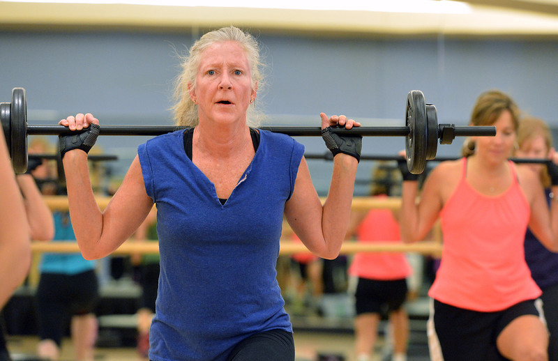 Katherine Crosby exercises with a weight bar during the Body Pump class at the Paul Derda Recreation Center on Thursday.<br /> January 3, 2013<br /> staff photo/ David R. Jennings