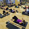 The Body Pump class do sit ups at the Paul Derda Recreation Center on Thursday.<br /> January 3, 2013<br /> staff photo/ David R. Jennings