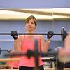 Pamela Carson exercises during Body Pump class at the Paul Derda Recreation Center on Thursday.<br /> January 3, 2013<br /> staff photo/ David R. Jennings