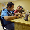 Anthony Rodriguez, left, works on a jigsaw puzzle with Bob Grizmala and staff member Rose Means in a multipurpose room at F.R.I.E.N.D.S. of Broomfield  on Friday.  F.R.I.E.N.D.S. is breaking ground on a new center this week.<br /> May 25, 2012 <br /> staff photo/ David R. Jennings