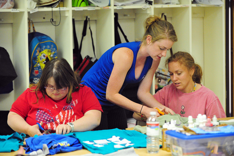 F.R.I.E.N.D.S. of Broomfield staff member Lynn Ersek, center, helps Sarah Miller, right, cut t-shirts with Jennifer Carpenter for a craft project in the multipurpose room on Friday.  F.R.I.E.N.D.S. is breaking ground on a new center this week.<br /> May 25, 2012 <br /> staff photo/ David R. Jennings