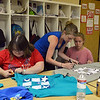 F.R.I.E.N.D.S. of Broomfield staff member Lynn Ersek, center, helps Sarah Miller, right, cut t-shirts along with Jennifer Carpenter for a craft project in the multipurpose room on Friday. <br /> May 25, 2012 <br /> staff photo/ David R. Jennings