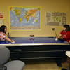 Amber Maes, left, plays air hockey with Jennifer Carpenter at F.R.I.E.N.D.S. of Broomfield current location on Friday.  <br /> May 25, 2012 <br /> staff photo/ David R. Jennings