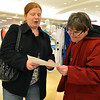 Erin Linenberger, left, and Tamra Woberman look  for what the next item they need to find during the FRIENDS of Broomfield scavenger hunt at FlatIron Crossing mall on Thursday.<br /> February 14, 2013<br /> staff photo/ David R. Jennings
