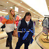 Molly Coufal, left, evening/social director, helps Christina Swiheart look for items on the scavenger hunt list during the FRIENDS of Broomfield scavenger hunt at FlatIron Crossing mall on Thursday.<br /> February 14, 2013<br /> staff photo/ David R. Jennings