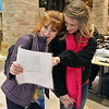 Kyla Roberts and staff member Lynn Ersek look at a paper during the FRIENDS of Broomfield scavenger hunt at FlatIron Crossing mall on Thursday.<br /> February 14, 2013<br /> staff photo/ David R. Jennings
